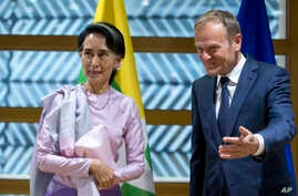 State Counsellor of Myanmar, Aung San Suu Kyi, left, is greeted by European Council President Donald Tusk at the Europa building in Brussels on May 2, 2017.