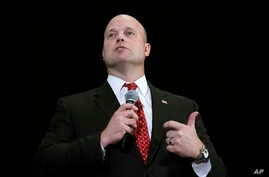 FILE - Matt Whitaker, then an Iowa Senate candidate, speaks during the Iowa Republican Party's annual Lincoln Day dinner in Cedar Rapids, Iowa, April 11, 2014.