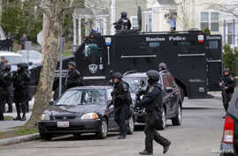 SWAT teams enter a suburban neighborhood searching for the remaining suspect in the Boston Marathon bombings in Watertown, Massachusetts April 19, 2013.