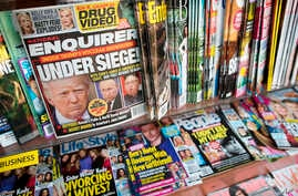 FILE - The cover of an issue of the National Enquirer is shown, featuring President Donald Trump at a store in New York, July 12, 2017.