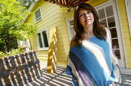File — Homeowner Ingrid Auyon, an attorney, outside her Lo