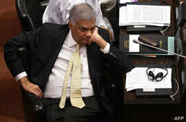 Sri Lanka's ousted Prime Minister Ranil Wickremesinghe looks on during a parliament session in Colombo, Dec. 12, 2018. On Sunday he was reinstated as prime minister, ending a political crisis.