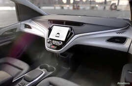 FILE - GM's planned Cruise AV driverless car features no steering wheel or pedals in this image from video, released Jan. 12, 2018.