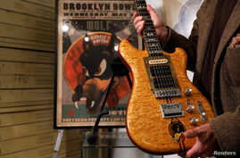 Late Grateful Dead front man Jerry Garcia's custom-made Wolf guitar, displayed here by Guernsey's Auctions, which plans to auction it with proceeds going to benefit the Southern Poverty Law Center, in New York, May 12, 2017.