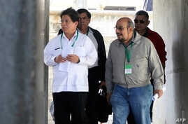 Nicaragua's Foregin Minister Denis Moncada (L), along with deputies Edwin Castro (R), Wilfredo Navarro (R back) and Jose Figueroa, leave as members of the opposition Civic Alliance failed to attend talks between the opposition and the government, in