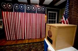 FILE - A ballot box is set for residents to vote in Dixville Notch, New Hampshire, Nov. 7, 2016. A request for detailed information about every voter in the U.S. from President Donald Trump's voting commission is getting a rocky reception in some sta...