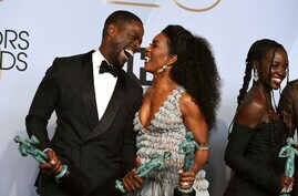 "Sterling K. Brown, left, laughs with Angela Bassett, winner of the award for  ""Black Panther"" at the 25th annual Screen Actors Guild Awards at the Shrine Auditorium & Expo Hall on Sunday, Jan. 27, 2019, in Los Angeles."