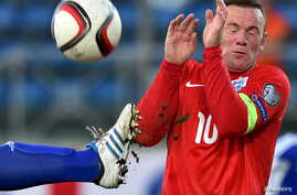 England's Wayne Rooney (R) covers himself during their Euro 2016 qualifying soccer match against San Marino at the Olympic stadium in Serravalle, San Marino, September 5, 2015.