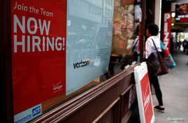 "A ""Now Hiring"" sign is posted on a Verizon store in Manhattan in New York City, May 10, 2016."