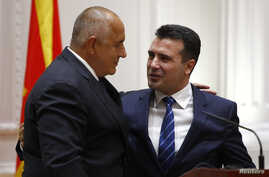 Bulgarian Prime Minister Boyko Borissov speaks to his Macedonian counterpart Zoran Zaev following an official signing ceremony in Skopje, Macedonia, Aug. 1, 2017.