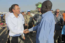U.N.'s top humanitarian official in the country Toby Lanzer, left, makes a visit to assess the humanitarian situation at the U.N. compound where many displaced have sought shelter in Bentiu, in oil-rich Unity state, in South Sudan, Dec. 24, 2013.