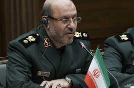 FILE - Iranian Defense Minister Hossein Dehghan listens to Russian Defense Minister Sergei Shoigu (not seen) during their meeting in Moscow, Russia, Dec. 20, 2016.