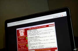 Screenshot of the warning screen from a purported ransomware attack, as captured by a computer user in Taiwan, is seen on laptop in Beijing, May 13, 2017.
