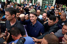 Jair Bolsonaro, far-right lawmaker and presidential candidate of the Social Liberal Party (PSL), gestures after casting his vote, in Rio de Janeiro, Brazil, Oct. 7, 2018.