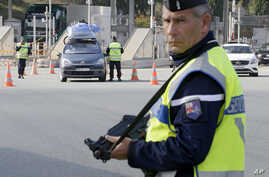 French police check vehicles at the France Italy border in La Turbie, southeastern France, Nov. 14, 2015.