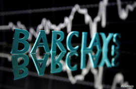 FILE - The Barclays logo is seen in front of displayed stock graph in this illustration taken June 21, 2017.