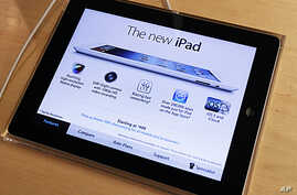 Apple's newest iPad is seen at the 5th Avenue Apple Store in New York, March 16, 2012.