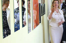 Svetlana Medvedev, wife of then-Russian President Dmitry Medvedev, visits a center for victims of domestic violence in Moscow, July 7, 2011.