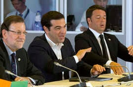 Greek Prime Minister Alexis Tsipras, center, speaks during a round table meeting at an emergency summit of eurozone heads of state and government at the EU Council building in Brussels, Belgium, July 7, 2015.
