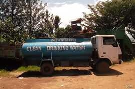 Large trucks transport clean water from the Nyamasaria Water Works in Kisumu, Kenya to customers (VOA/A. Khayesi)