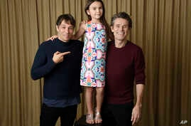 "In this Sept. 9, 2017 photo, writer-director Sean Baker, from left, actress Brooklynn Prince and actor Willem Dafoe pose together to promote their film,  ""The Florida Project,"" during the Toronto International Film Festival in Toronto."