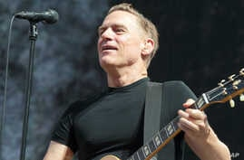 """FILE - Singer-songwriter Bryan Adams performs in concert during his """"Reckless - 30th Anniversary Tour 2015"""" at the Delaware State Fair, July 28, 2015."""