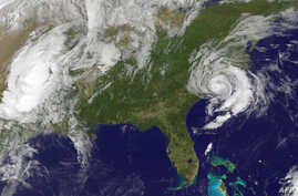 This May 10, 2015 NOAA satellite photo shows Tropical Storm Ana(R) off the Carolinas in the US. Tropical storm Ana made landfall on the US southeastern coast Sunday, risking flooding, high winds and life-threatening tides in the region, forecasters w