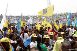 Supporters of Congolese President Joseph Kabila attend a pro-government rally in the Democratic Republic of Congo's capital Kinshasa, July 29, 2016.