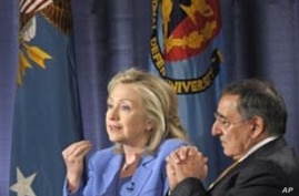 Secretary of State Hillary Rodham Clinton, accompanied by Defense Secretary Leon Panetta, speaks during an event at the National Defense University in Washington, Tuesday, Aug. 16, 2011