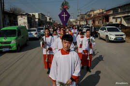 The Palm Sunday procession makes its way toward a government-sanctioned church in Youtong village, Hebei province, China, March 25, 2018.