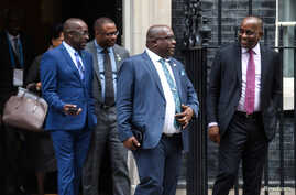 FILE - Timothy Harris, St Kitts and Nevis Prime Minister, and other Caribbean leaders and representatives leave following a meeting with Britain's Prime Minister Theresa May at 10 Downing Street in London, Britain, April 17, 2018.