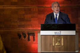 Israeli Prime Minister Benjamin Netanyahu speaks during the Holocaust Remembrance Day ceremony at the Yad Vashem Holocaust memorial in Jerusalem, April 11, 2018.