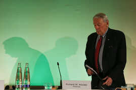 Dick Pound, who heads the commission into corruption and doping in athletics, arrives for a news conference in Unterschleissheim, near Munich, Germany, Jan. 14, 2016.