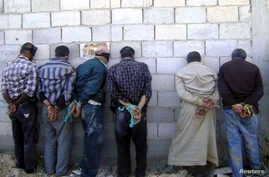 """A photo distributed by Syria's national news agency SANA, May 22,2013, shows detainees described by SANA as """"terrorists fighters"""", a term commonly used to describe rebels fighting to topple President Bashar al-Assad, Qusair, near Homs."""