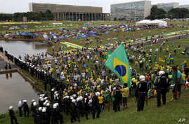 Demonstrators take part in a protest against Brazil's President Dilma Rousseff in front of the Brazilian National Congress in Brasilia, Nov. 15, 2015.