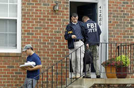FBI Investigators leave the home of Farooque Ahmed in Ashburn, Va. Ahmed, a naturalized citizen born in Pakistan was arrested Wednesday and charged with trying to help people posing as al-Qaida operatives planning to bomb subway stations around the n