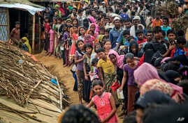 Rohingya Muslims, who from Myanmar into Bangladesh, wait in queues to receive aid at Kutupalong refugee camp in Ukhiya, Bangladesh, Nov. 15, 2017. Secretary of State Rex Tillerson called for an independent investigation into a humanitarian crisis in ...