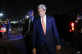 U.S. Secretary of State John Kerry is seen by his plane in Tel Aviv, Israel, Wednesday, July 23, 2014, engaged in shuttle diplomacy on the Gaza conflict.