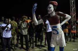 A supporter of New Patriotic Party with a number 5 painted on his body — referring to the position occupied by the party on the electoral roll for the Ghana national elections on December 7 — takes part in a prayer vigil in Koforidua, Nov. 16, 2016.