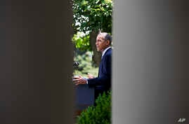 President Barack Obama makes a statement about immigration reform, in the Rose Garden of the White House in Washington, June 30, 2014.
