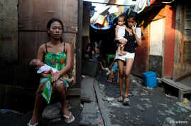 Residents are seen outside their shanties in Navotas, Metro Manila, Philippines, Oct. 28, 2017.