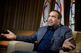 Kuwaiti Sheik Ahmad Al-Fahad Al-Sabah speaks during an interview with the Associated Press, Oct. 26, 2015, in Washington. Kuwait was suspended by the IOC for political interference, leaving its athletes in limbo.