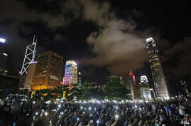 Protesters wave their mobile phones during a rally, after China's legislature has ruled out open nominations in elections for Hong Kong's leader in Hong Kong, Aug. 31, 2014.