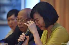 "Veronica Tan, the wife of former Jakarta governor, Basuki Tjahaja Purnama, popularly known as ""Ahok,"" weeps during a news conference in Jakarta, May 23, 2017  in this photo taken by Antara Foto."