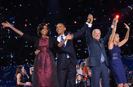US President Barack Obama (2nd L), First Lady Michelle Obama (L), Vice-President Joe Biden and Second Lady Jill Biden wave to supporters following Obama's speech on election night November 6, 2012 in Chicago, Illinois.
