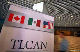 A NAFTA banner is seen during the fifth round of NAFTA talks involving the United States, Mexico and Canada, in Mexico City, Nov. 18, 2017.