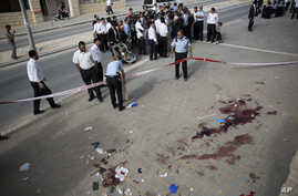 Israeli police officers inspect the scene of a stabbing attack in Beit Shemesh, central Israel, Oct. 22, 2015. Police say two Palestinians stabbed an Israeli man in the city of Beit Shemesh after attempting to board a bus ferrying children to school....