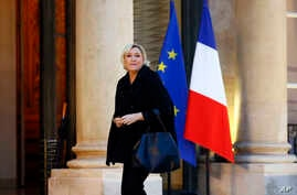 French far-right Front National Party President Marine Le Pen arrives for a meeting with French President Emmanuel Macron at the Elysee Palace, in Paris, Nov. 21, 2017.