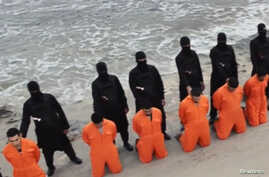 FILE - Captives in orange jumpsuits — purported to be Egyp