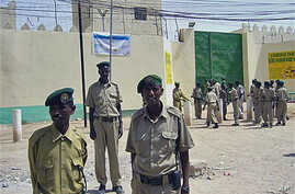 Guards stand outside the prison that houses 70 pirate inmates, in the breakaway northern republic of Somaliland, March 2011. (file photo)